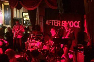 Aftershock Band Background